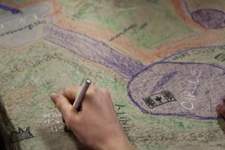 A hand drawing a map.