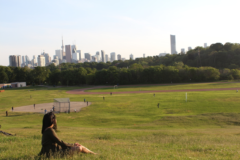 Celeena looking out at the Toronto skyline